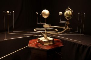 Photograph of solar system model, apparently clockwork